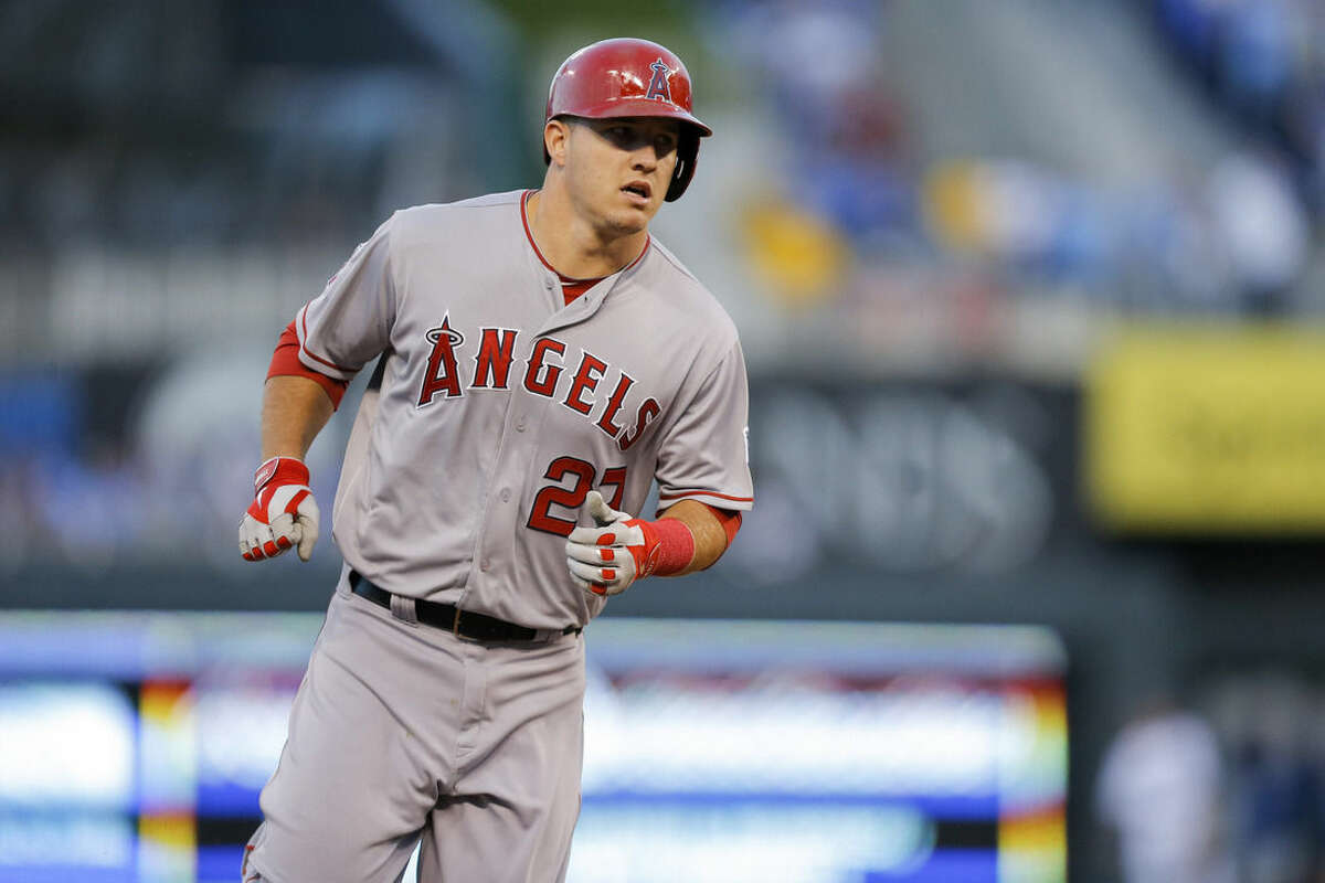 Los Angeles Angels center fielder Mike Trout (27) rounds the bases after hitting a solo home run against the Kansas City Royals during the first inning of Game 3 of baseball's AL Division Series in Kansas City, Mo., Sunday, Oct. 5, 2014. (AP Photo/Travis Heying)