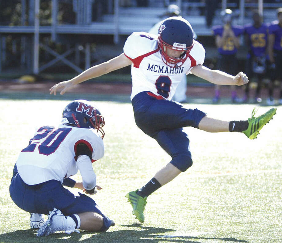 Hour photo/John Nash - Brien McMahon kicker Niko Petridis attempts a 47-yard field goal during Friday's game at Westhill. Petridis was back for the first time this season after a health scare.