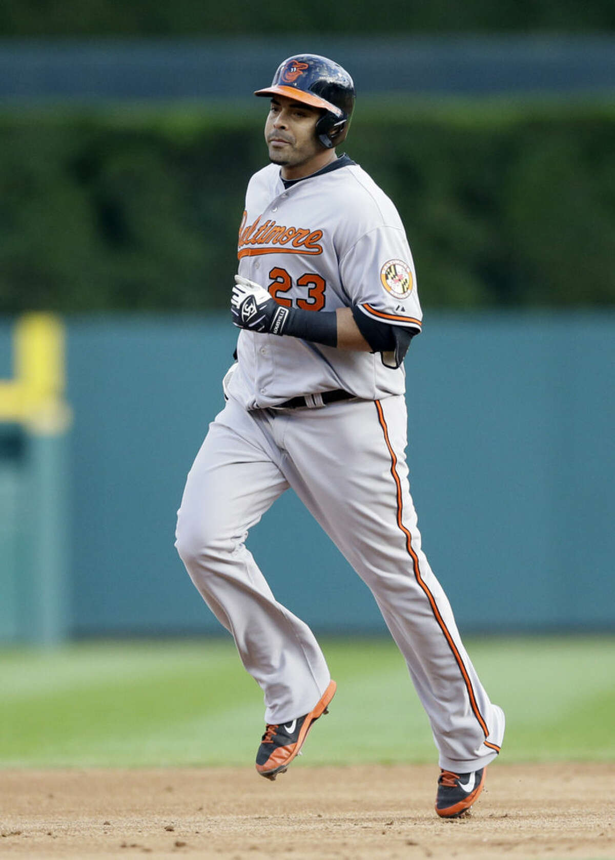 Baltimore Orioles designated hitter Nelson Cruz (23) rounds the bases after hitting a two-run home run in the sixth inning in Game 3 of baseball's AL Division Series against the Detroit Tigers Sunday, Oct. 5, 2014, in Detroit. (AP Photo/Carlos Osorio)