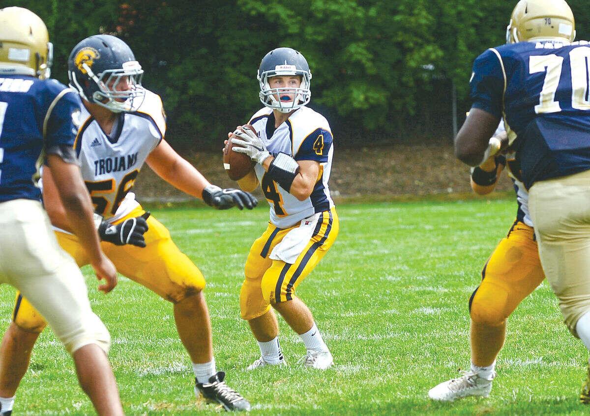 Weston's Alex Fruhbeis looks to pass as Weston High School football takes on Notre Dame-Fairfield on Saturday. (Hour photo / Erik Trautmann)