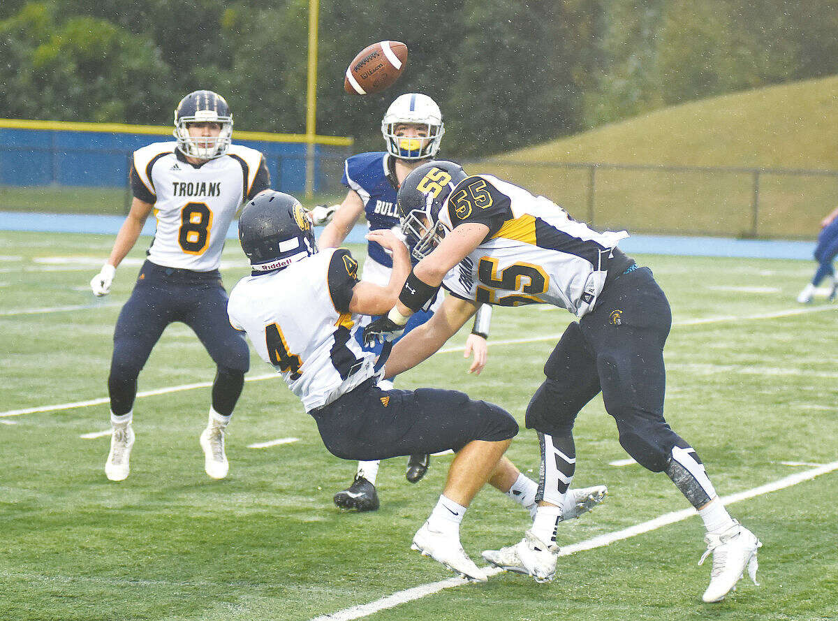 Hour photo/John Nash - Weston's Alex Fruhbeis (4) and Zac Spencer (55) collide trying to make an interception as teammate Jason Lawrence (8) and Bunnell's Kyle Bannister look. Bannister caught the deflection and raced 43 yards into the end zone for a TD pass as the Bulldogs posted a 34-14 win.