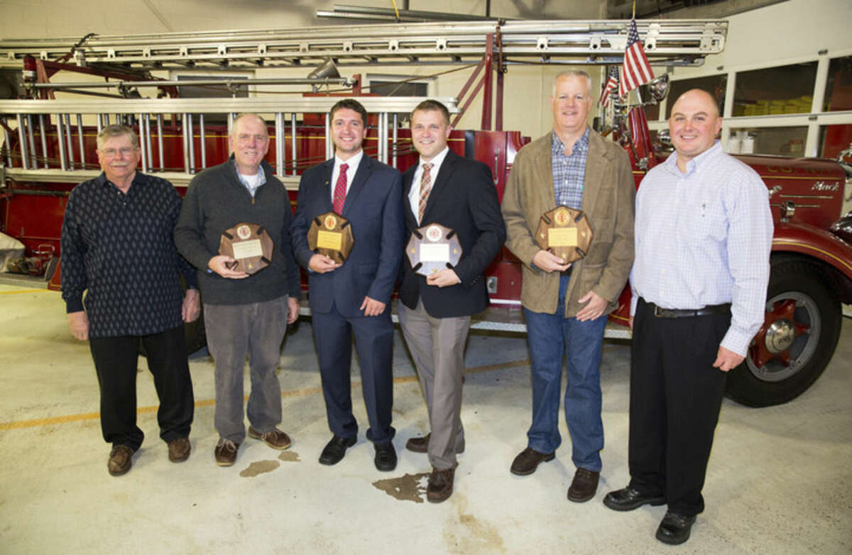 Hour photo/Chris Palermo Principals at the 114th annual dinner of Rowayton Hose Company No. 1, from left: President Jack Raymond, former Chief Edwin Carlson, Firefighter Sean McAleer, Deputy Chief Jake Raymond, Assistant Chief Dan Oak and Chief Todd DeKlyn.