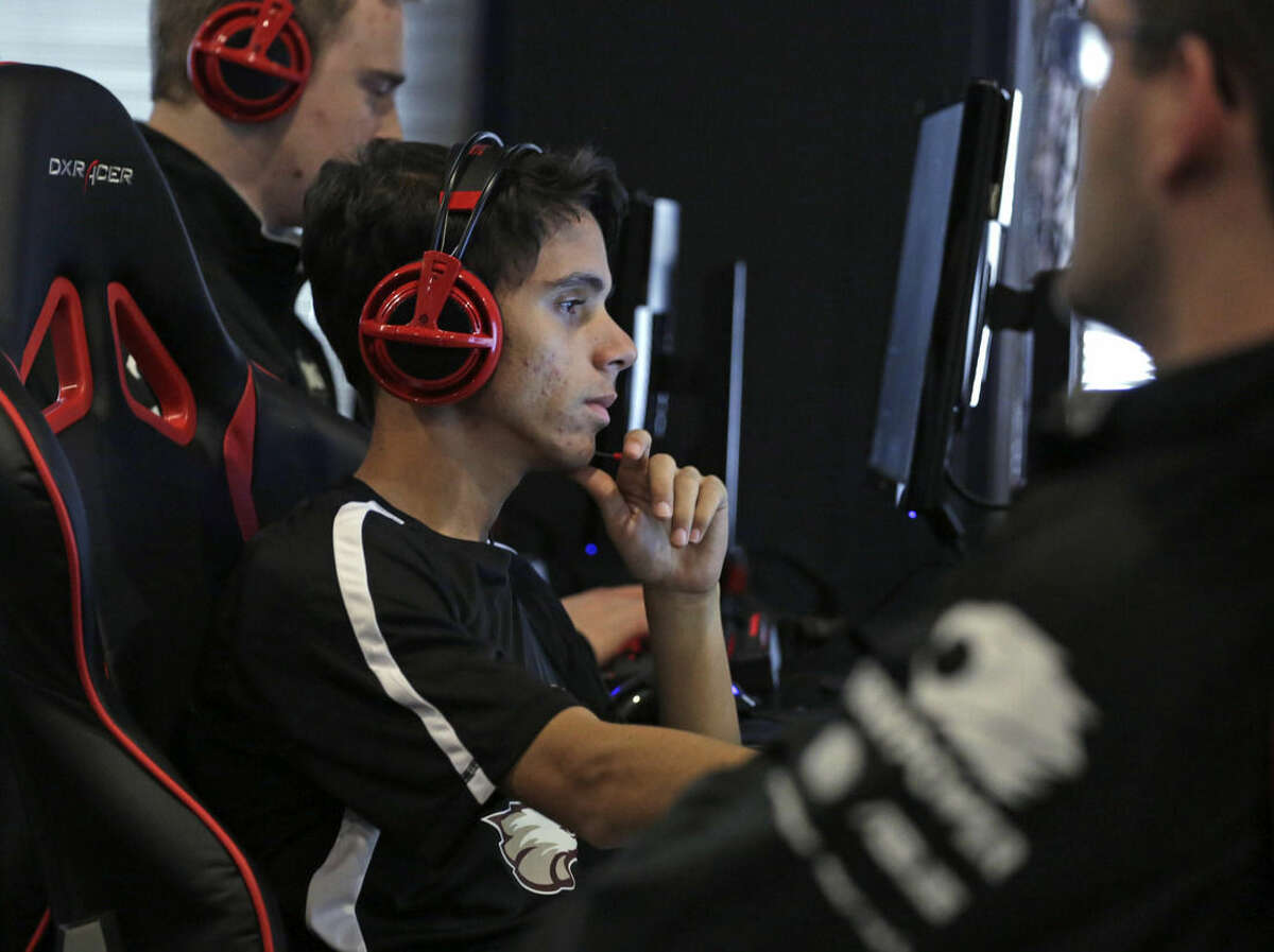 In this Sept. 23, 2014 photo, Robert Morris University Illinois student Luis Ferrera practices playing the video game