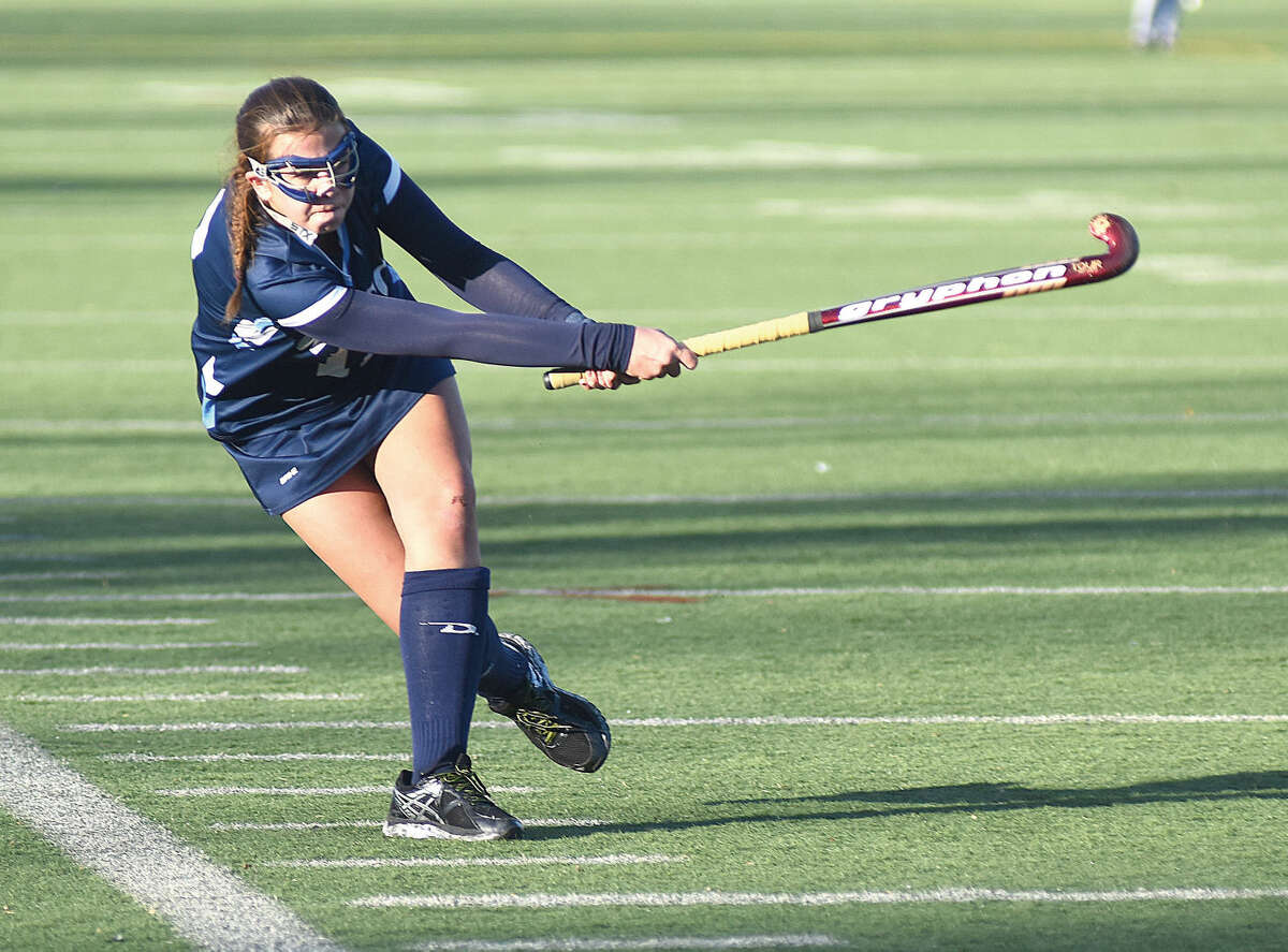 Hour photo/John Nash Jessica Hendry of Wilton lets a drive fly during the first half of Saturday's CIACClass l championship game against Cheshire at Cottone Field in Wethersfield. Wilton won the game, 1-0, in overtime to give the Warriors their fourth state title in five years.
