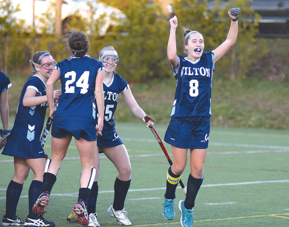 Hour photo/John Nash Jillian Mahon (8) of Wilton leaps into the air after scoring the game-winning goal in Saturday's CIACClass L championship game at Cottone Field in Wethersfield. Wilton won, 1-0, in overtime.
