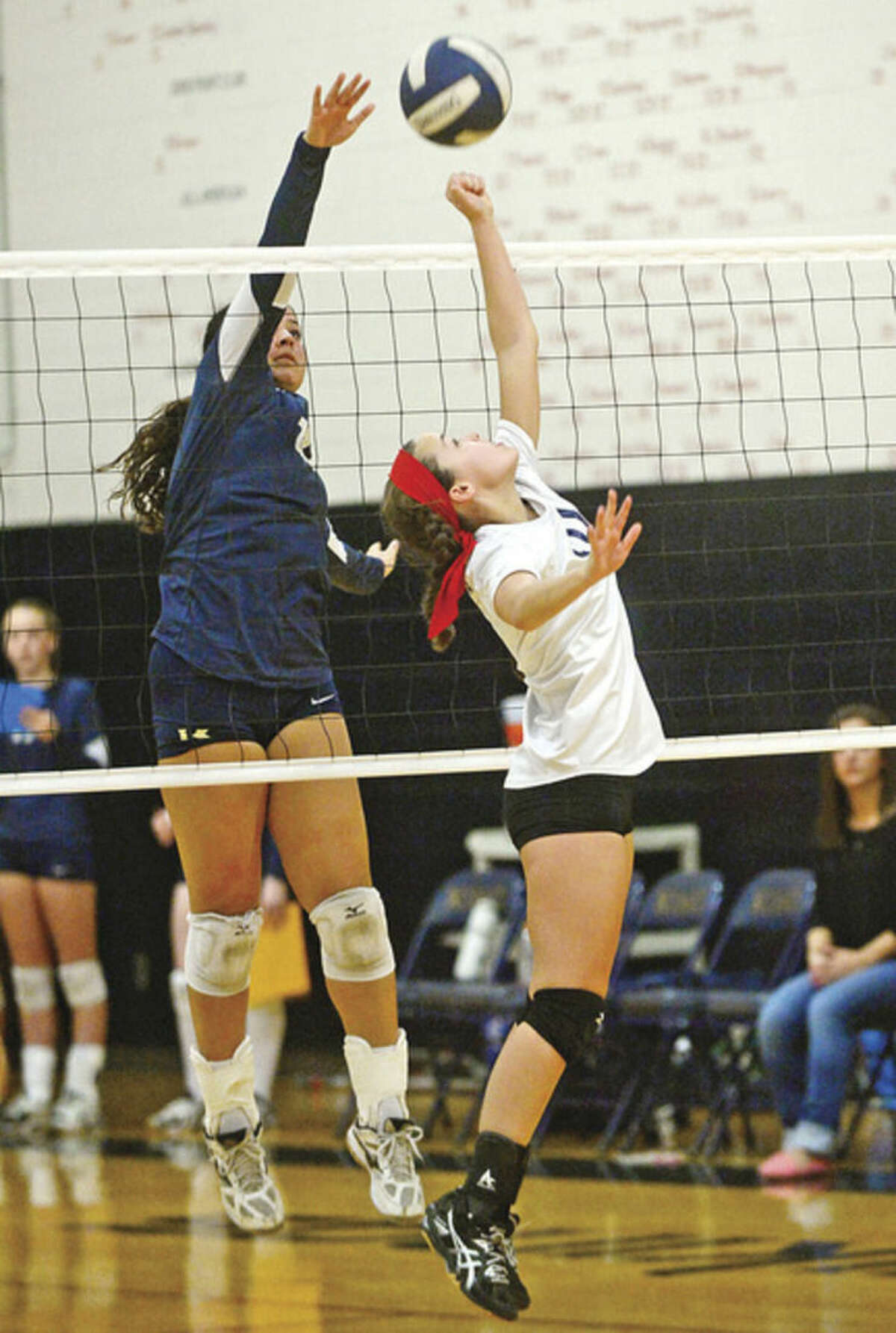 Hour photo/Erik Trautmann King School's Ryan Correa (blue) looks to block the ball against GFA's Meg Nesi as the King School hosts Greens Farms Academy in a New Englnad tournament volleyball semifinal on Saturday.