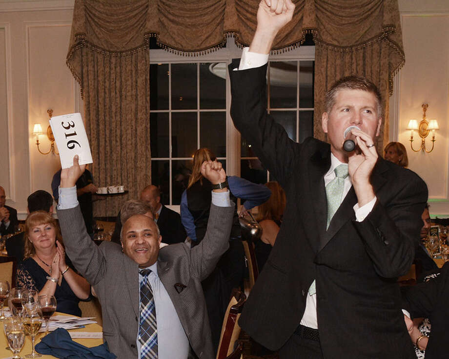 Photo by Miggs Burroughs Riaz Rahman makes a winning bid at the live auction at the STAR Gala 2015.