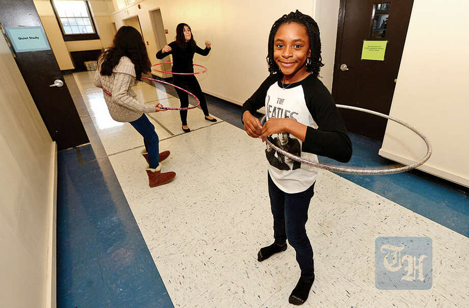 Hour photo / Erik Trautmann 10 year old Jordyn Dixon and her friends play with a hula hoops during free time in the Choices for Success after school program at the Ben Franklin Center Friday. Choices for Success is a program of the Child Guidance Center and provides academic and enrichment activities for middle and high school students.