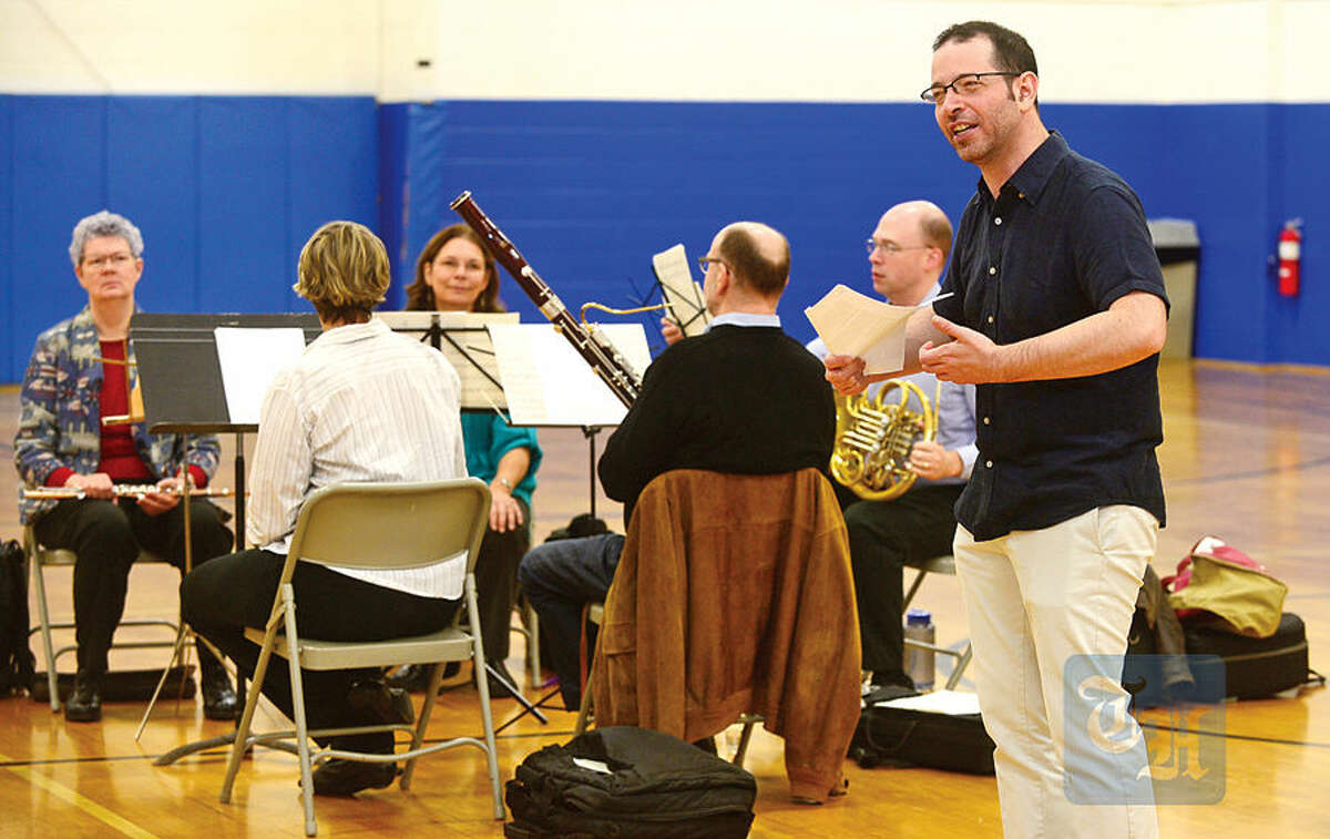 Hour photo / Erik Trautmann Jonathan Yates with the Norwalk Symphony gives an overview as Symphony musicians conduct an interactive performance for children at the Carver Center Saturday.