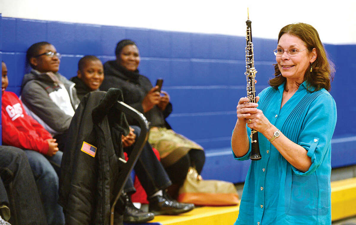 Hour photo / Erik Trautmann Norwalk Symphony musicians including Janet Rosen conduct an interactive performance for children at the Carver Center Saturday