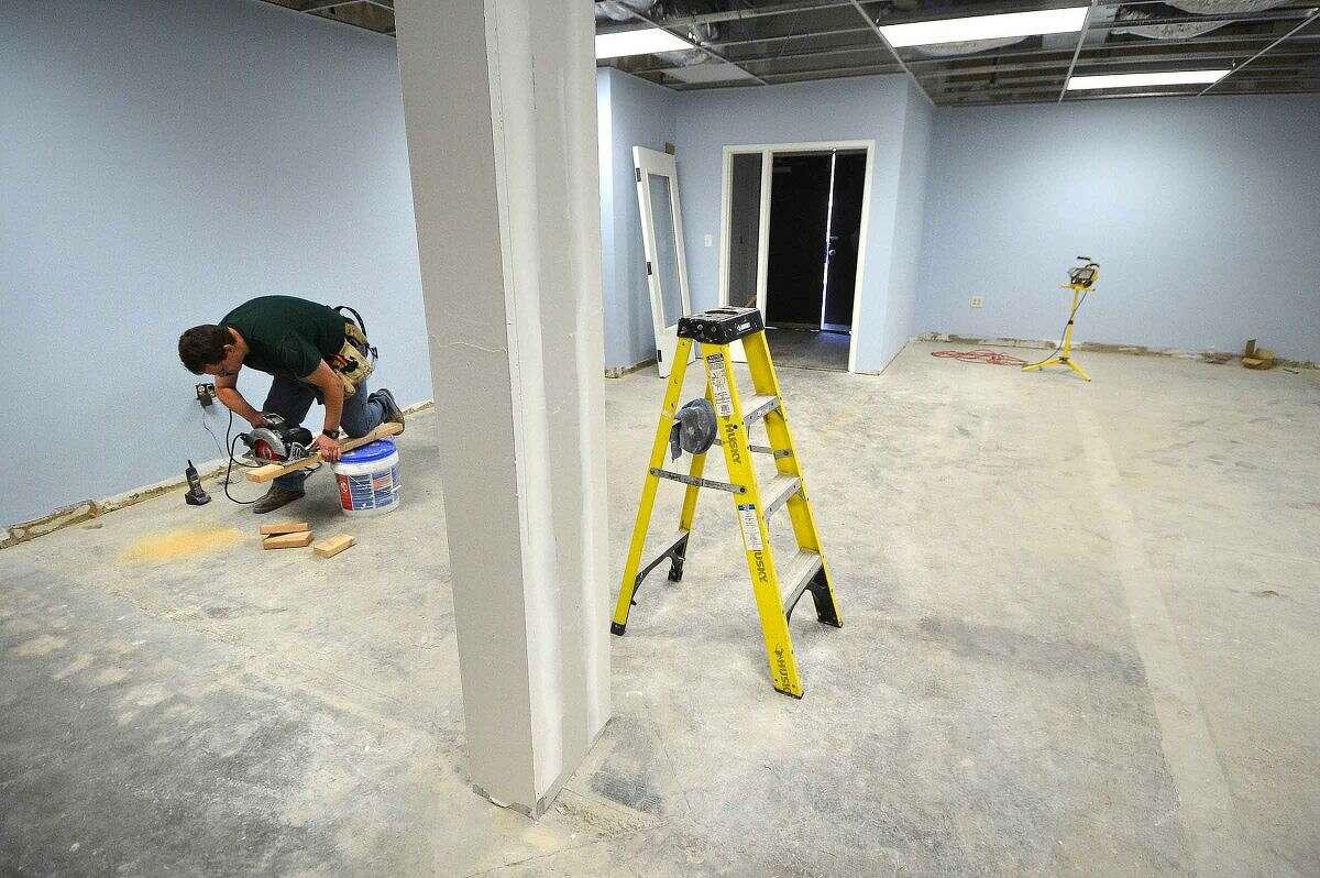 Hour Photo/Alex von Kleydorff New bedrooms under construction at the South Norwalk Community Center