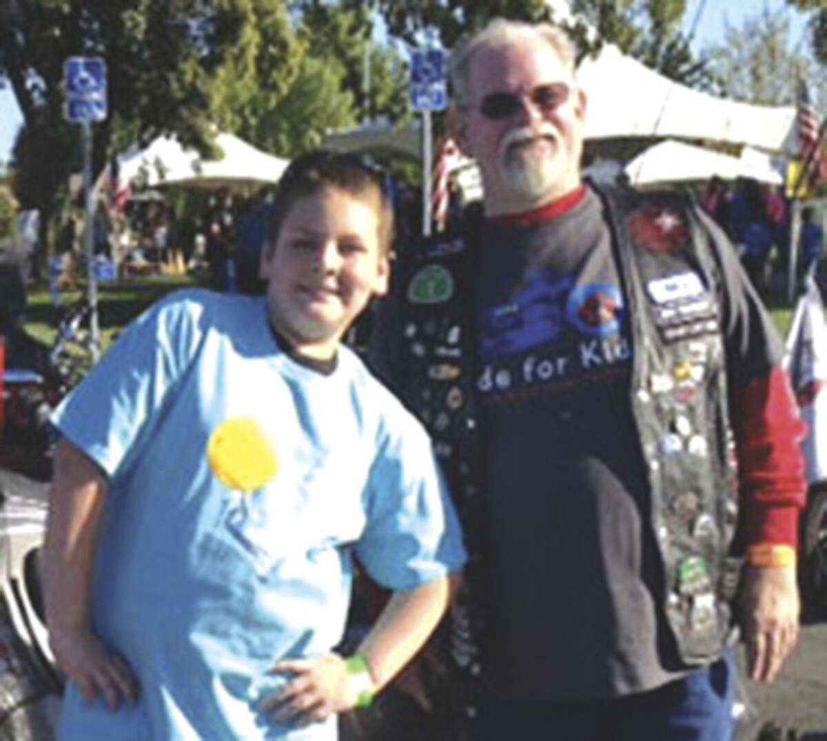Contributed photo Star Elias, left, and his VIP escort, unidentified, smile before the Northern California Ride for Kids.