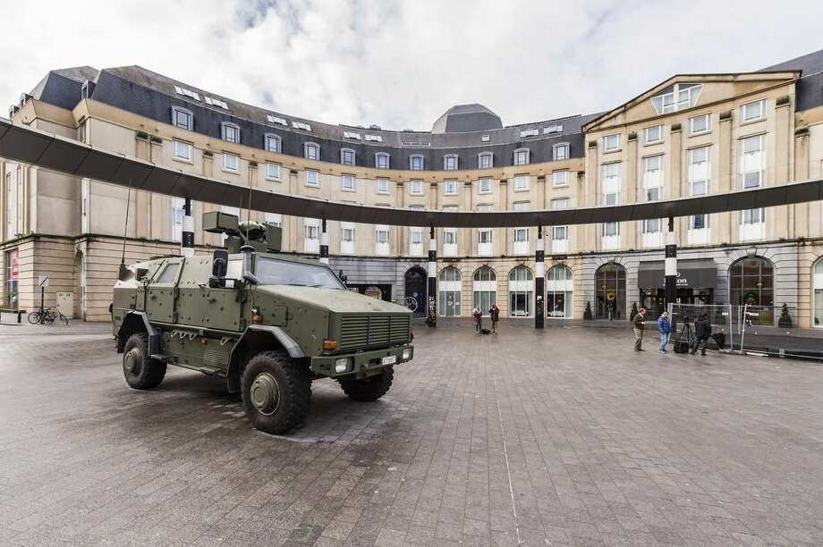 A Belgian Army vehicle is parked on the almost deserted square in front of the main train station in the center of Brussels on Sunday, Nov. 22, 2015. Western leaders stepped up the rhetoric against the Islamic State group on Sunday as residents of the Belgian capital awoke to largely empty streets and the city entered its second day under the highest threat level. With a menace of Paris-style attacks against Brussels and a missing suspect in the deadly Nov. 13 attacks in France last spotted crossing into Belgium, the city kept subways and underground trams closed for a second day. (AP Photo/Geert Vanden Wijngaert)