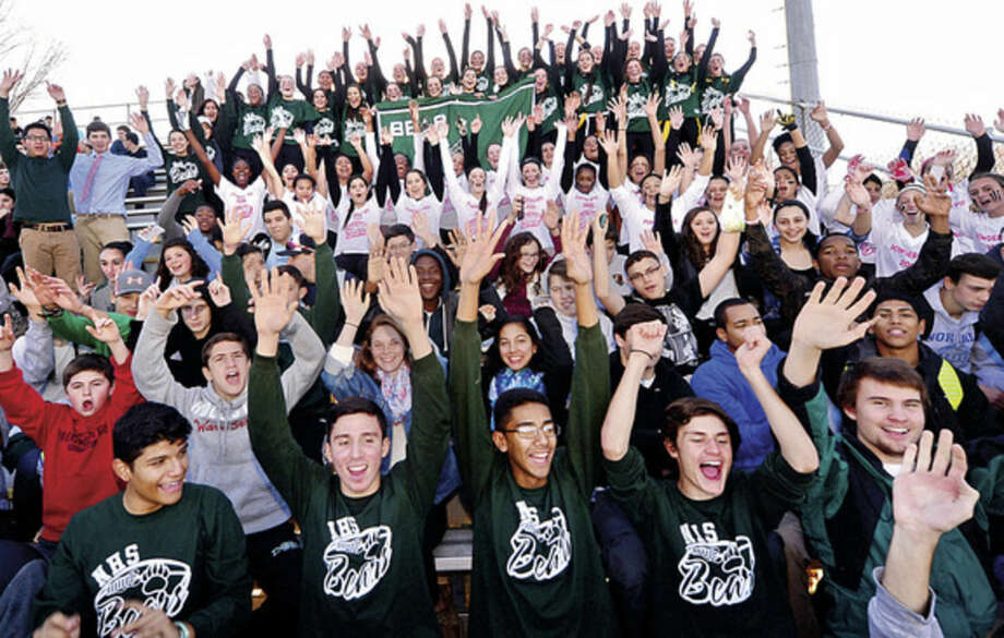 Hour photo / Erik Trautmann Norwalk High School sports fans, affectionately known as the Bear Pack, cheer at the Powder Puff football game Friday.
