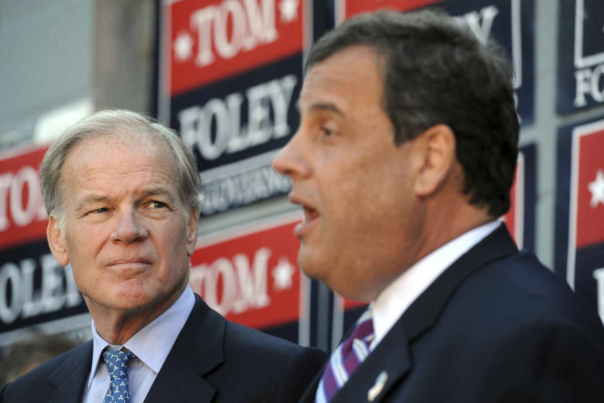 New Jersey Gov. Chris Christie, right, joins Connecticut Republican gubernatorial candidate Tom Foley, left, during a stop in Trumbull, Conn., Monday, Oct. 6, 2014. It was Christie's third trip to Connecticut stumping for Foley and other Republican candidates. Foley is challenging incumbent Democrat Gov. Dannel P. Malloy in the Nov. 4 election. (AP Photo/Connecticut Post, Ned Gerard) MANDATORY CREDIT