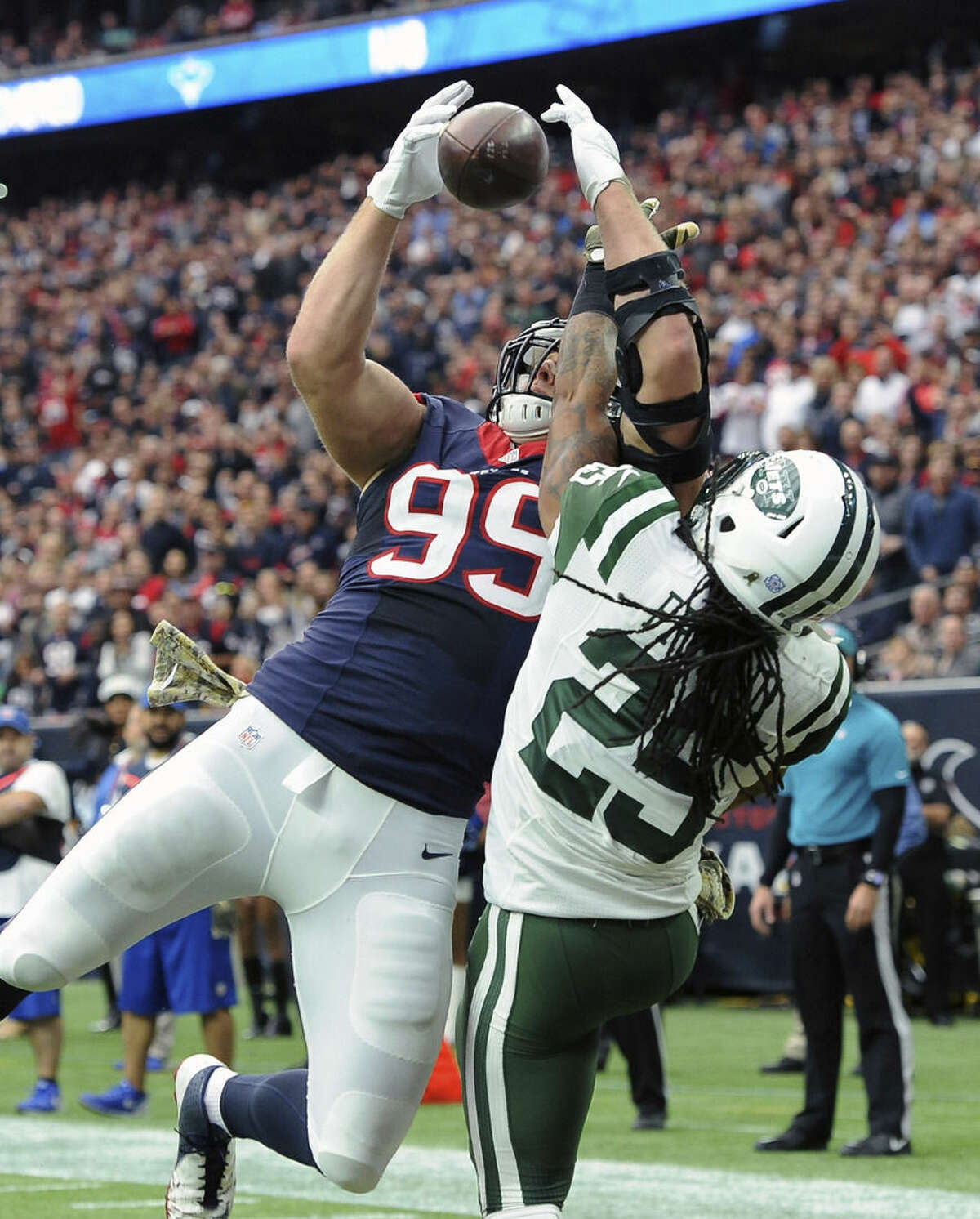 New York Jets strong safety Calvin Pryor (25) breaks up a pass intended for Houston Texans' J.J. Watt (99) in the end zone during the first half of an NFL football game, Sunday, Nov. 22, 2015, in Houston. (AP Photo/George Bridges)