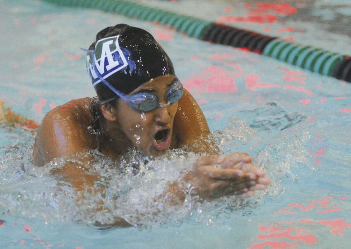 Hour photo/Matthew Vinci Norwalk/McMahon's Chatturjee Anoubhka competes in the 200 medley relay during Monday's meet against Wilton in Norwalk.