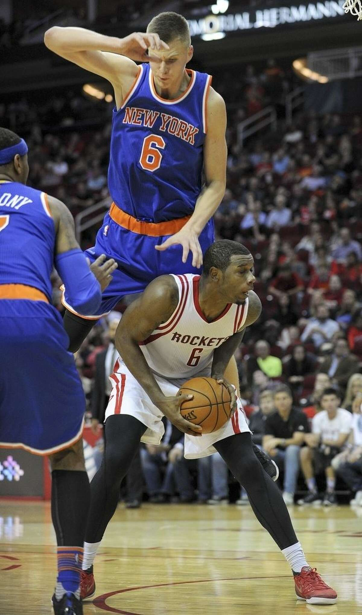 Houston Rockets forward Terrence Jones, bottom, drives to the basket as New York Knicks forward Kristaps Porzingis, top, defends in the second half of an NBA basketball game, Saturday, Nov. 21, 2015, in Houston. (AP Photo/Eric Christian Smith)