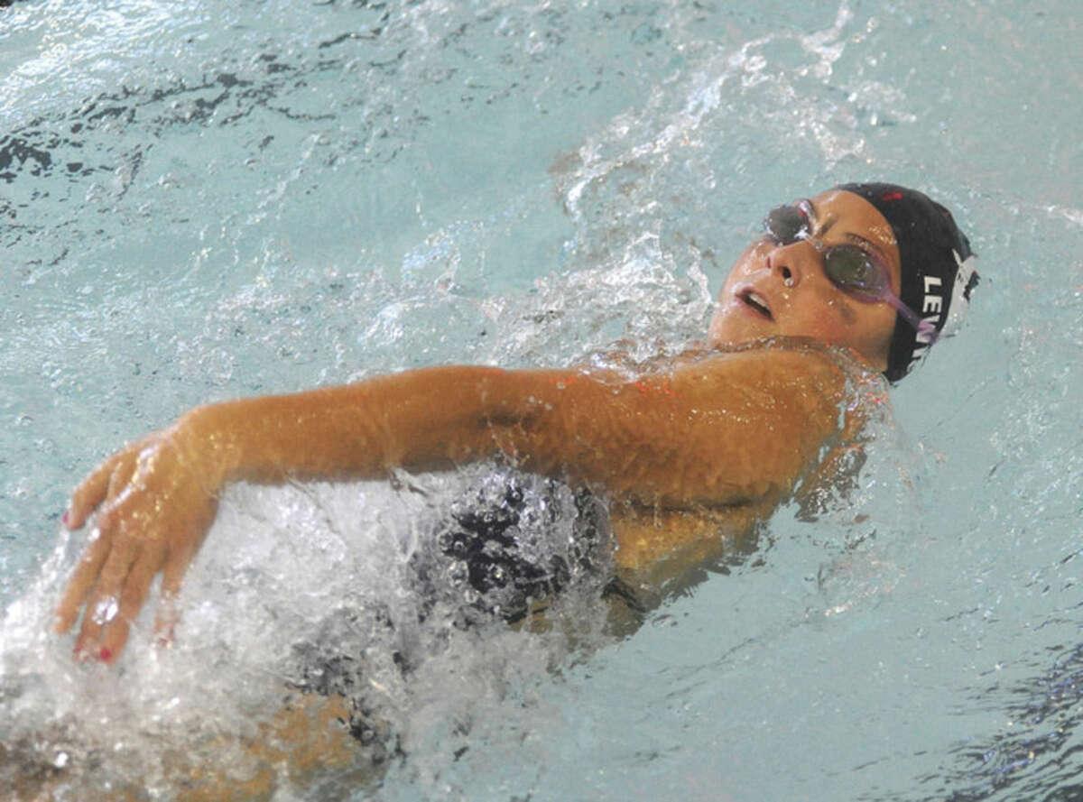 Hour photo/Matthew Vinci Wilton's Julia Lewis does the backstroke during Monday's meet in Norwalk against the Norwalk/McMahon co-op.