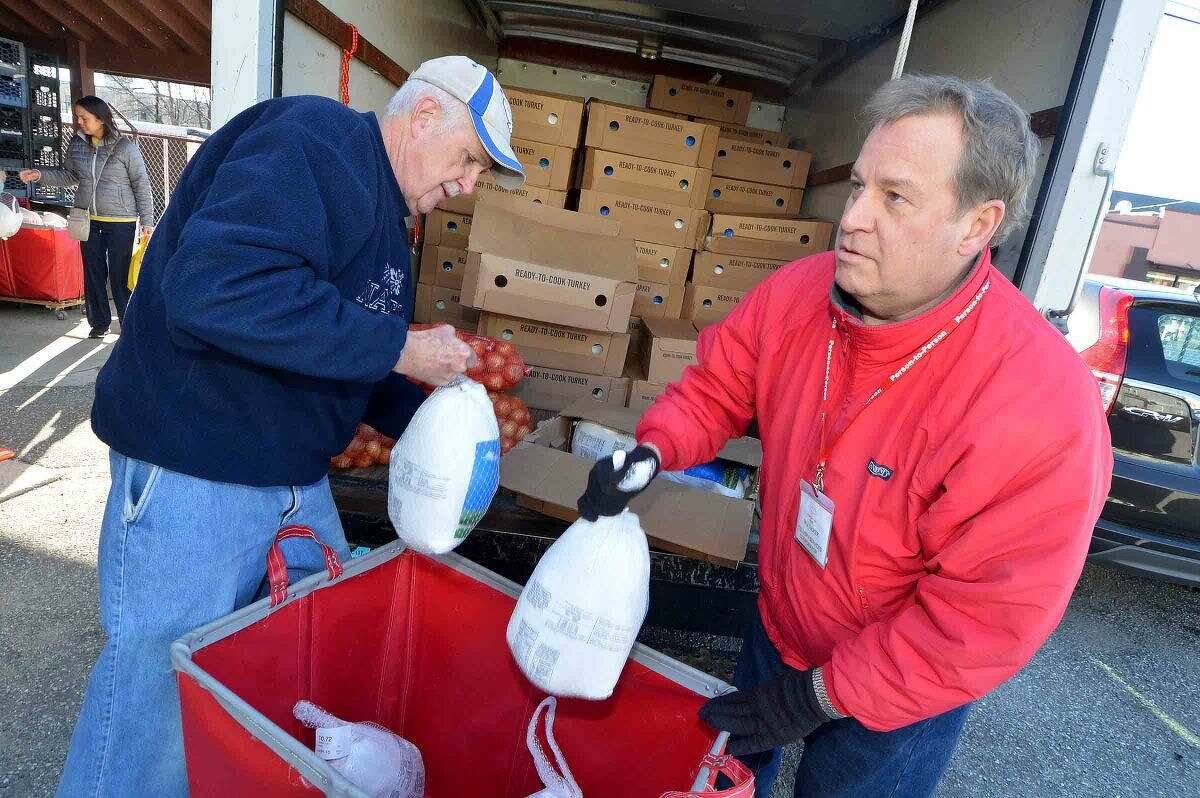 Hour Photo/Alex von Kleydorff Person to Person distributes turkeys and all the trimmings for a Thanksgiving dinner to those in need