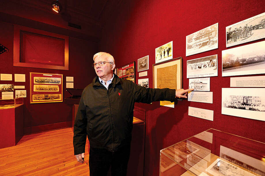 "Stamford Historical Society volunteer Dan Burke describes the new exhibit, ""Stamford School Days: 1641-1971."" The exhibit outlines the history of schools built in Stamford from the 1600s to present."