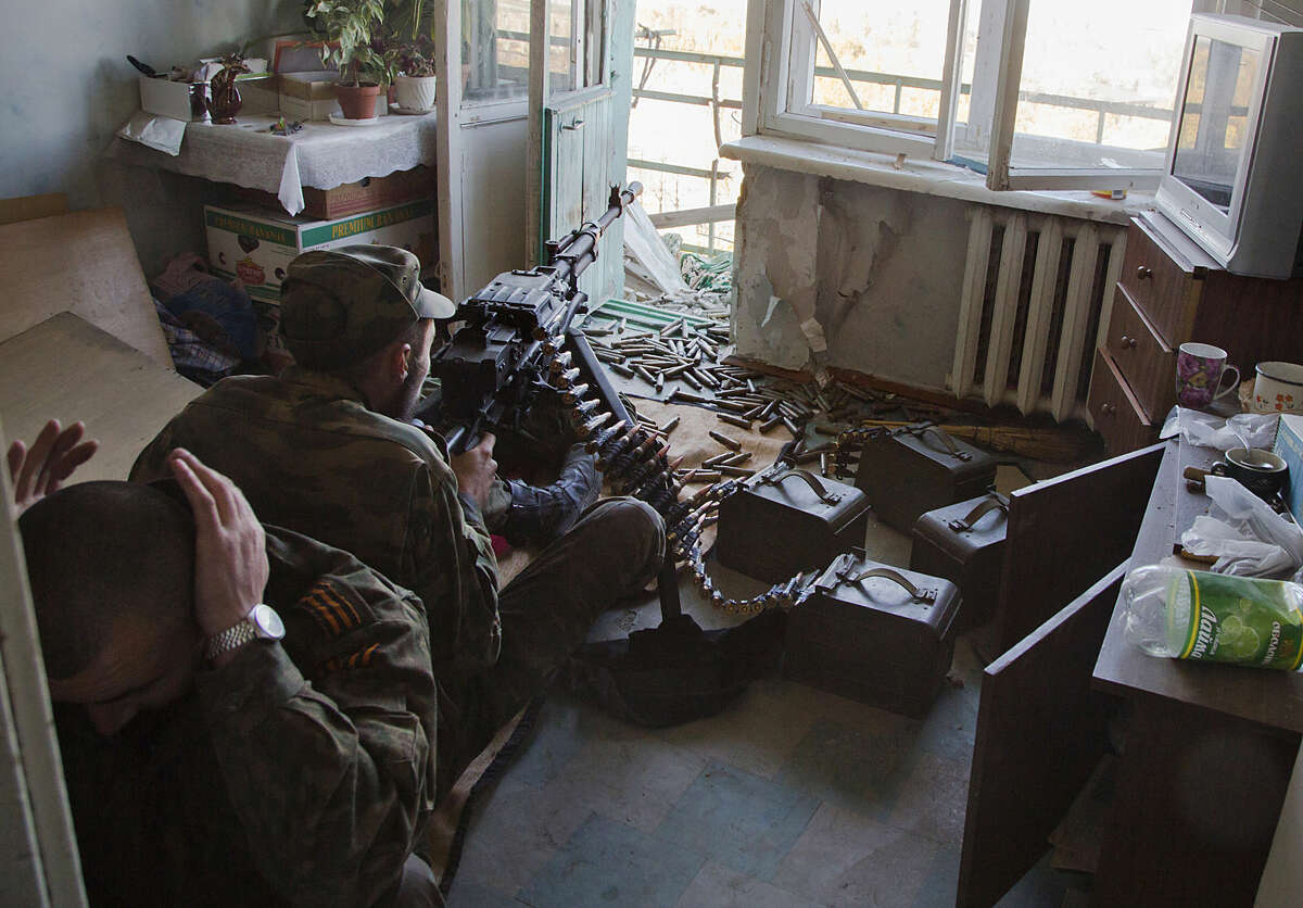Pro-Russian rebels fire toward Ukrainian positions near to the airport in the town of Donetsk, eastern Ukraine Tuesday, Oct. 7, 2014. Despite a cease-fire declared a month ago between the Ukrainian forces and pro-Russian rebels, the biggest city in eastern Ukraine remains embroiled in fighting . (AP Photo/Dmitry Lovetsky)