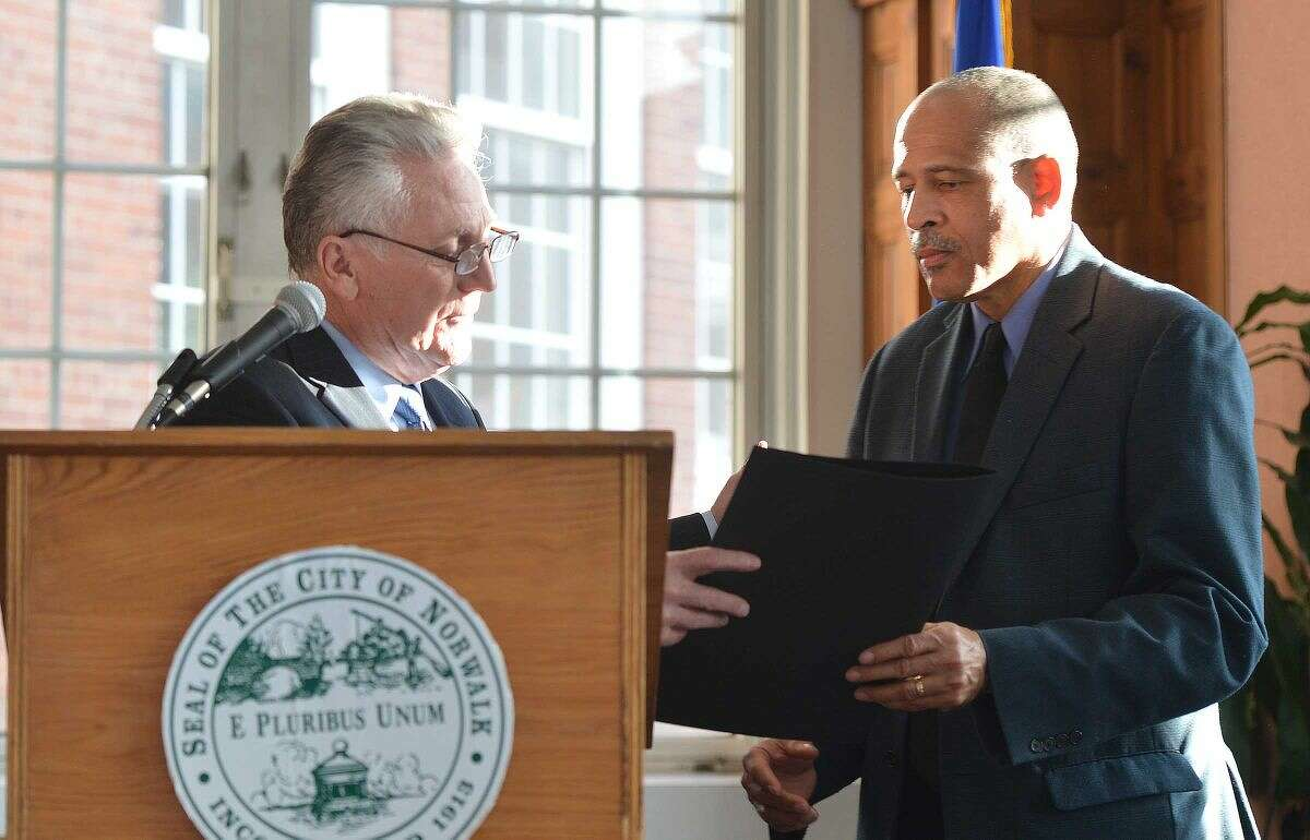 Hour Photo/Alex von Kleydorff In this file photo, Mayor Harry Rilling reads then presents a proclamation for April being fair housing month at Norwalk Fair Housing Advisory Commission and Norwalk NAACP screening of the film