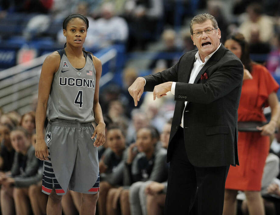 Connecticut head coach Geno Auriemma, right, gestures to his team as Connecticut's Moriah Jefferson, left, looks on, during the first half of an NCAA college basketball game, Monday, Nov. 23, 2015, in Hartford, Conn. (AP Photo/Jessica Hill)