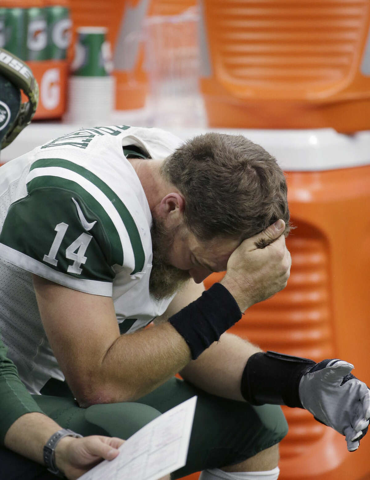 New York Jets quarterback Ryan Fitzpatrick sits on the bench during the second half of an NFL football game against the Houston Texans, Sunday, Nov. 22, 2015, in Houston. (AP Photo/David J. Phillip)