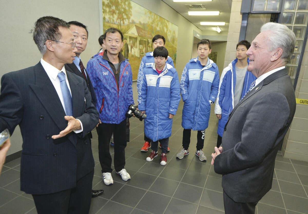 Hour photo/Alex von Kleydorff Chinese swimmers meet Mayor Harry Rilling and tour City Hall Monday with Mark Yin, head of Culture Division for U.S. Eddies Sports, and Eddie Shi, director of the U.S. Eddies Sports & Cultural Exchange Center.