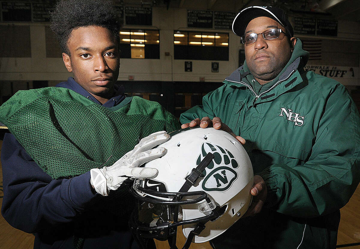 Norwalk's Dakari Eason, left, and his dad Darrick Eason, who is an assistant coach, will play and coach in their final game together on Thursday. Darrick, a former Norwalk football player himself, has coached Dakari for three years in high school and had coached him through youth football. (Hour photo/Matthew Vinci)