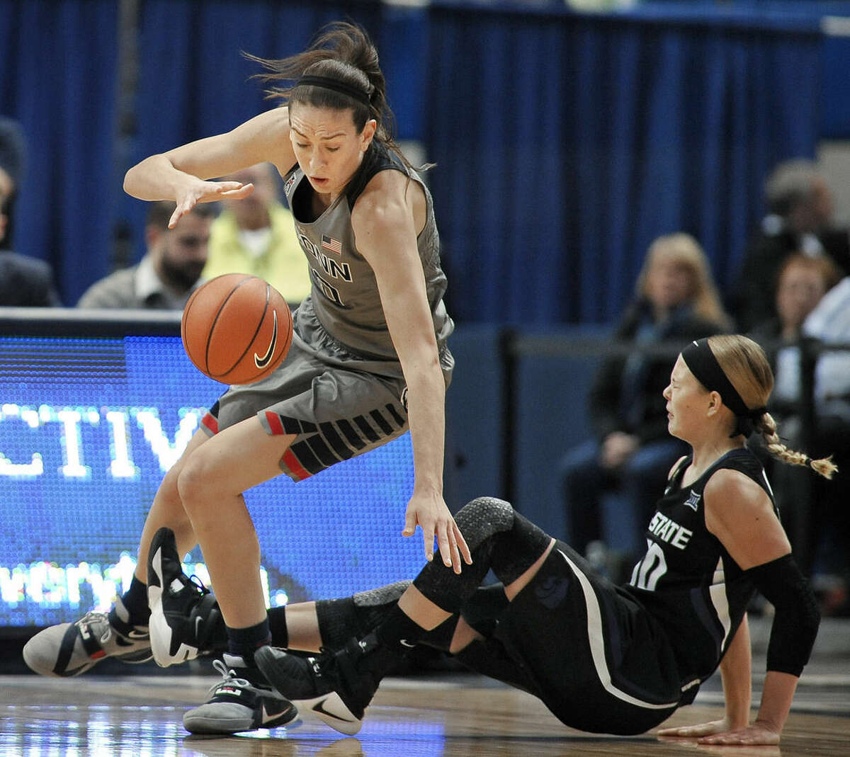 Connecticut's Breanna Stewart reaches for the ball after colliding with Kansas State's Kayla Goth, right, during the first half of an NCAA college basketball game, Monday, Nov. 23, 2015, in Hartford, Conn. (AP Photo/Jessica Hill)