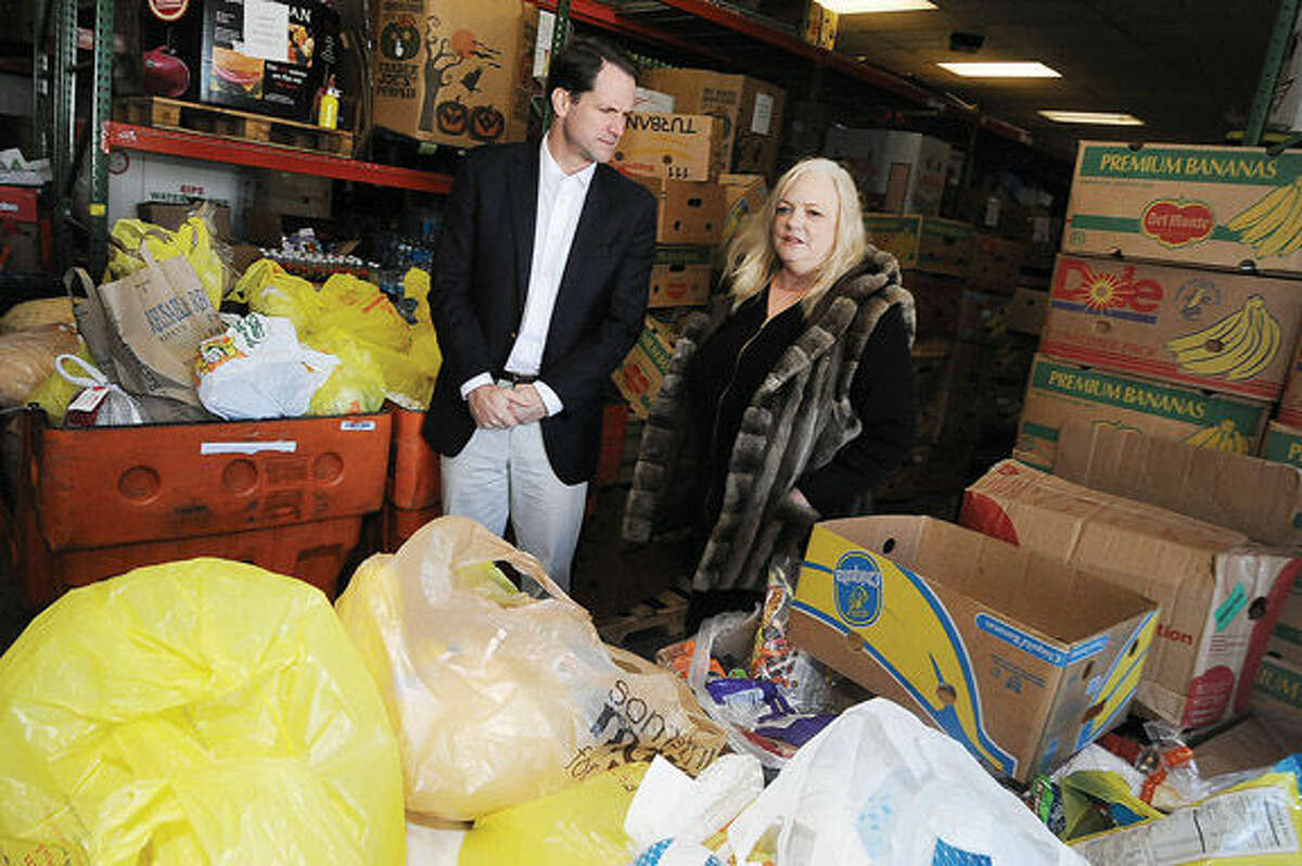 Congressman Jim Himes pays a visit and donates a turkey and canned goods to The Food Bank of Lower Fairfield County on Monday and speaks with Executive Director Kathleen Lombardo.