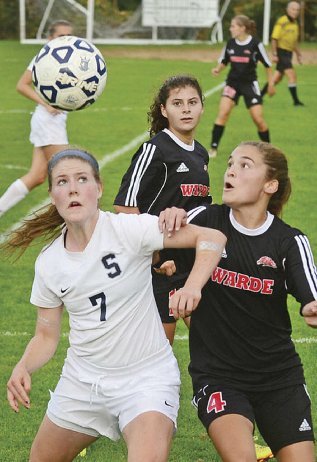 Hour photo/Erik Trautmann Staples High School's Chloe Rosenfield battles with Claire Pullen of Fairfield Warde during Tuesday's game in Westport.