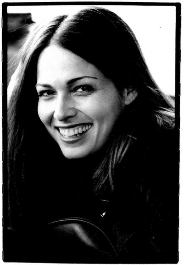 "This undated photo provided by the Goldberg family shows movie and television actress Sarah Goldberg Goldberg who starred in ""7th Heaven"" and ""Jurassic Park III,"" died Sept. 27, at age 40 in her sleep from natural causes, at the family's cabin in Wisconsin her mother Judy Goldberg said. Goldberg's entertainment career started as a bumblebee in a Chicago City Ballet production of ""Cinderella,"" and gained momentum when she was asked to be an extra on the Julia Roberts movie ""My Best Friend's Wedding."" The actress sometimes was credited under the stage name Sarah Danielle Madison. (AP Photo/Courtesy the Goldberg family) NO SALES"