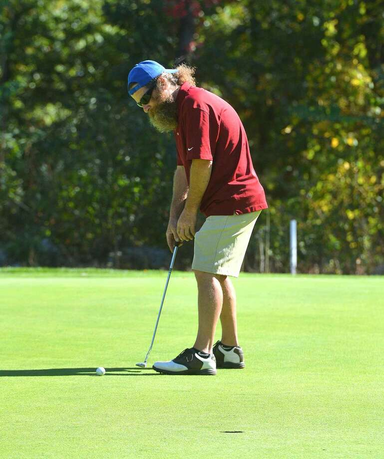 Hour Photo/Alex von Kleydorff Michael Moore send one to the cup on the 4th hole at Oak Hills Park