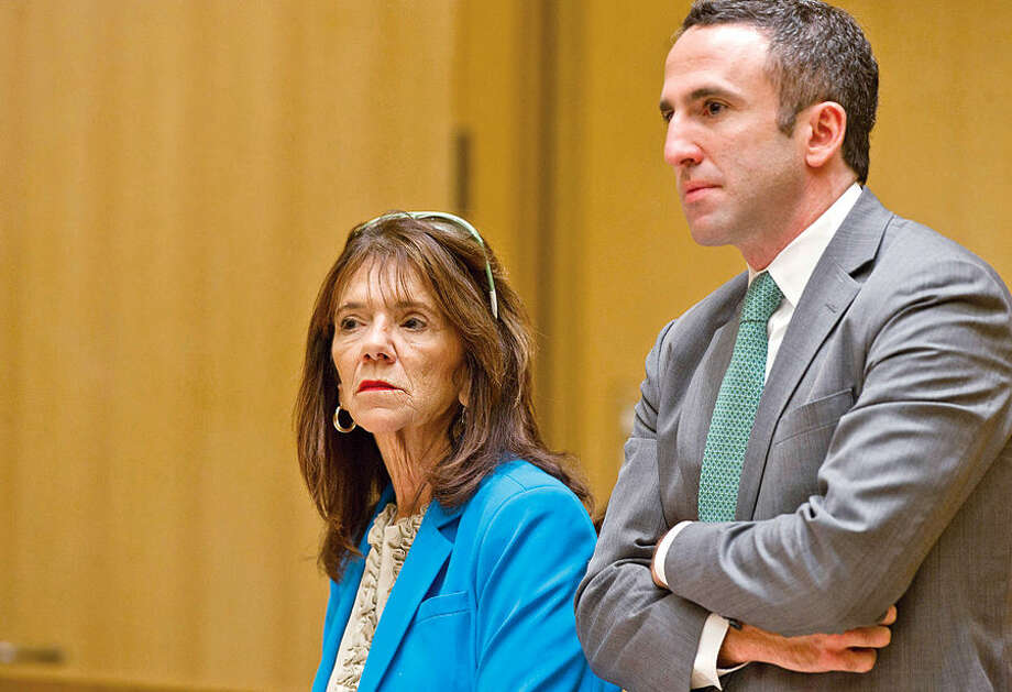 Stamford High School Principal Donna Valentine is arraigned at State Superior Court in Stamford, Conn., on Wednesday, October 8, 2014, with her attorney, Mark Sherman, for allegedly failing to report a sexual relationship between teacher Danielle Watkins and an 18-year-old student. (Pool photo/Lindsay Perry/Stamford Advocate)