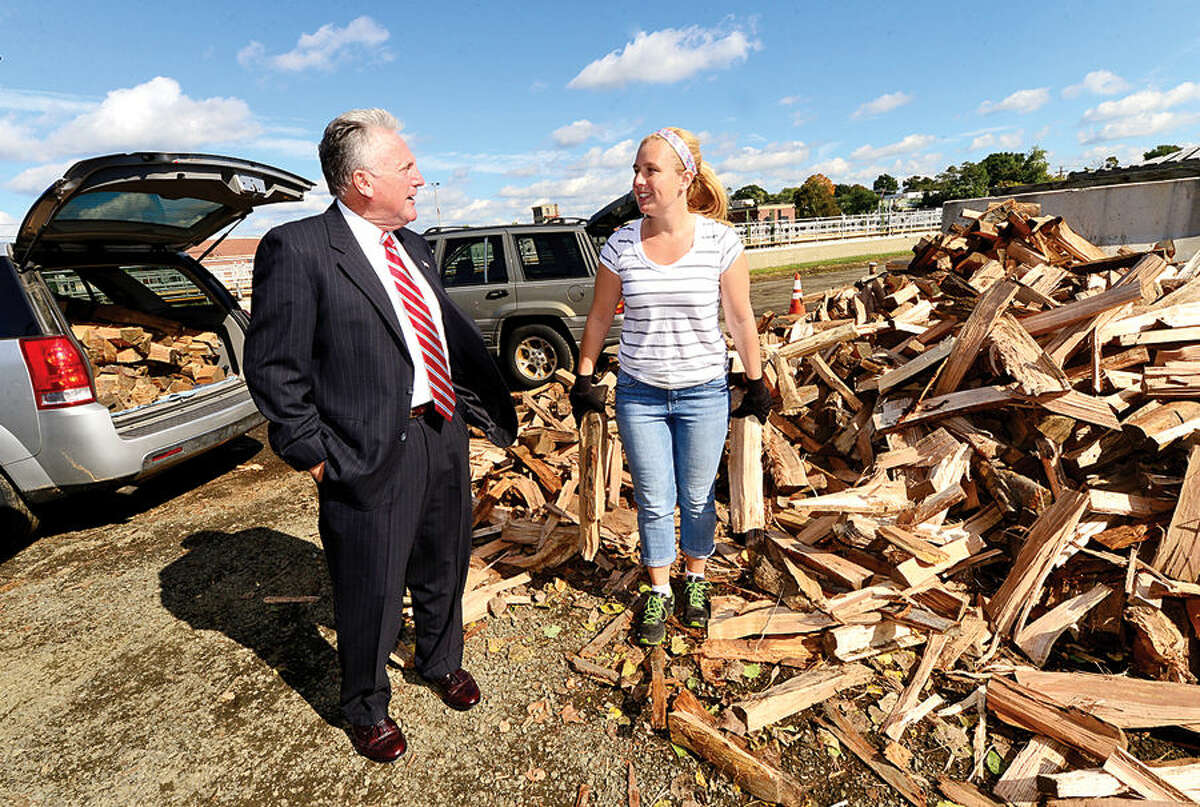 Hour photo / Erik Trautmann Norwalk Mayor Harry Rilling chats with resident Jennifer Merritt as he visited the Department of Public Works Yard Waste Debris Site on South Smith St. Wednesday in honor of the unprecedented success of the City of Norwalk's new Resident Firewood Program. The first set of firewood vouchers had sold out online in 11 minutes on Monday morning. The Energy and Environment Task Force started the program in conjunction with the Recreation and Parks Department.