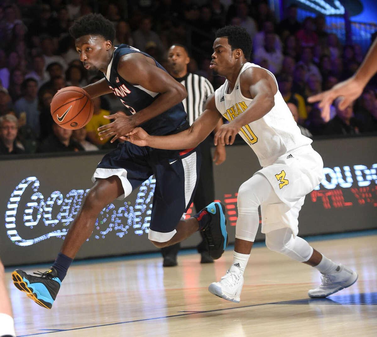 Connecticut forward Daniel Hamilton (5) drives to the basket past Michigan guard Derrick Walton Jr. (10) during an NCAA college basketball game at Paradise Island, Bahamas, Wednesday, Nov. 25, 2015. (Brad Horrigan/The Courant via AP)