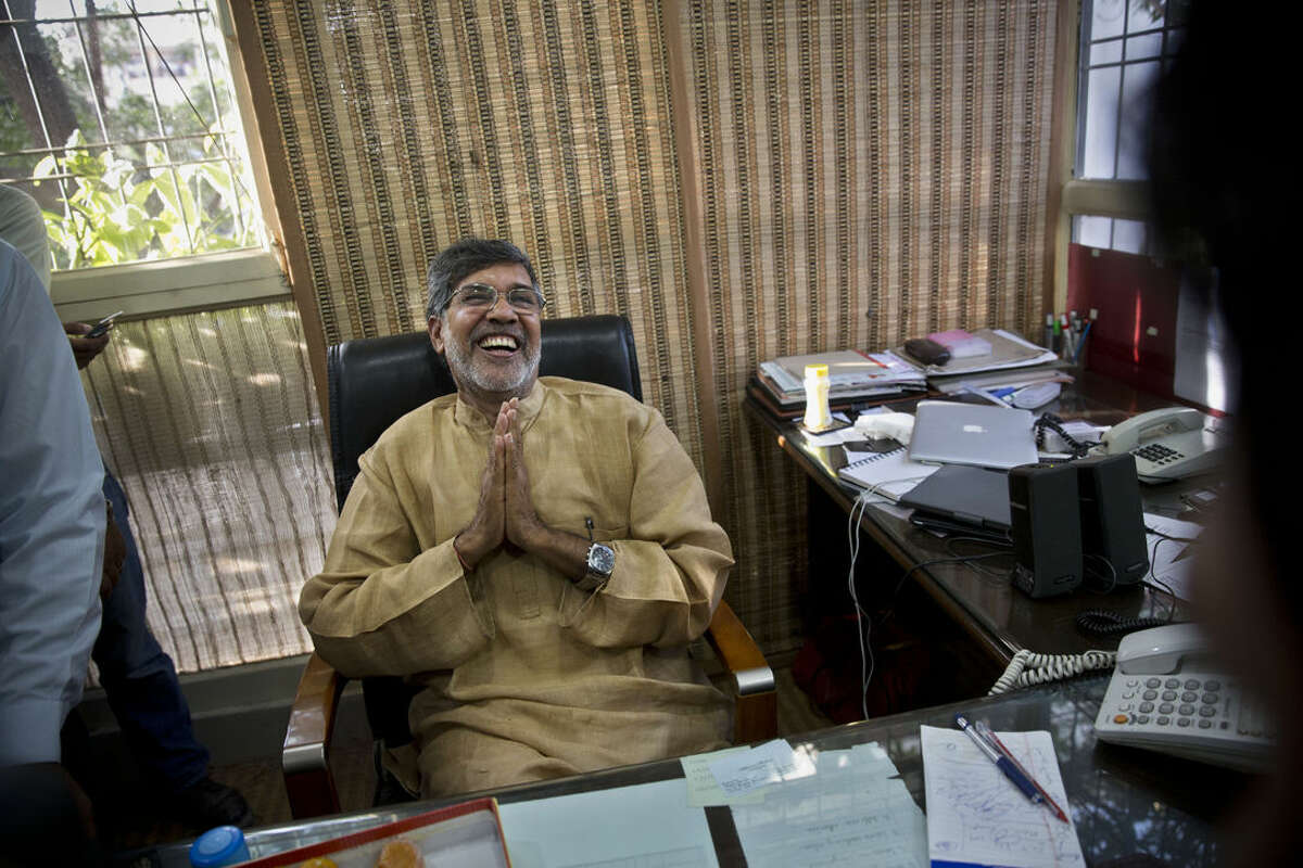 Indian children's rights activist Kailash Satyarthi laughs as he addresses the media at his office in New Delhi, India, Friday, Oct. 10, 2014. Malala Yousafzai of Pakistan and Satyarthi of India jointly won the Nobel Peace Prize on Friday, Oct. 10, 2014, for risking their lives to fight for children's rights. (AP Photo/Bernat Armangue)