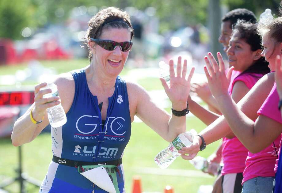 Abbe Karmen of Greenwich finishes the sprint triathalon during the third annual Navigators Stamford KIC IT race weekend to benefit Kids in Crisis at Cummings Beach in Stamford, Conn., on Sunday, June 12, 2016. Photo: Lindsay Perry, For Hearst Connecticut Media / Stamford Advocate Freelance