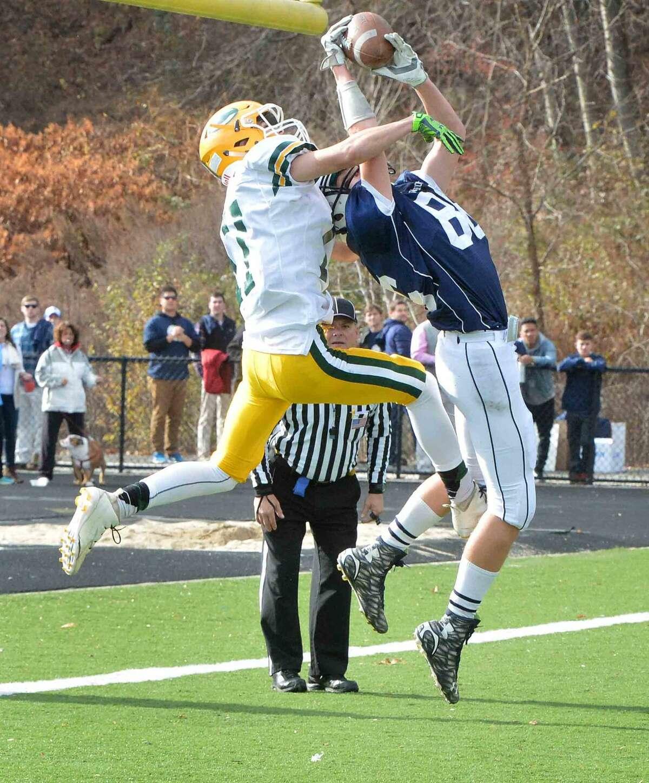 Hour Photo/Alex von Kleydorff Wiltons #86 Robert Hermann makes the catch for a touchdown vs Trinity's #17 John Petrizzi