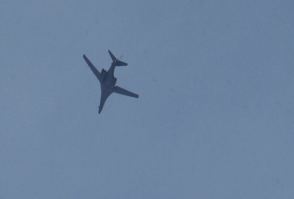 A military aircraft flies over Mursitpinar on the outskirts of Suruc, at the Turkey-Syria border, as it approaches Syria to deliver an airstrike in Kobani, where fighting intensified between Syrian Kurds and the militants of Islamic State group, Thursday, Oct. 9, 2014. Kobani, also known as Ayn Arab, and its surrounding areas, has been under assault by extremists of the Islamic State group since mid-September and is being defended by Kurdish fighters.(AP Photo/Lefteris Pitarakis)