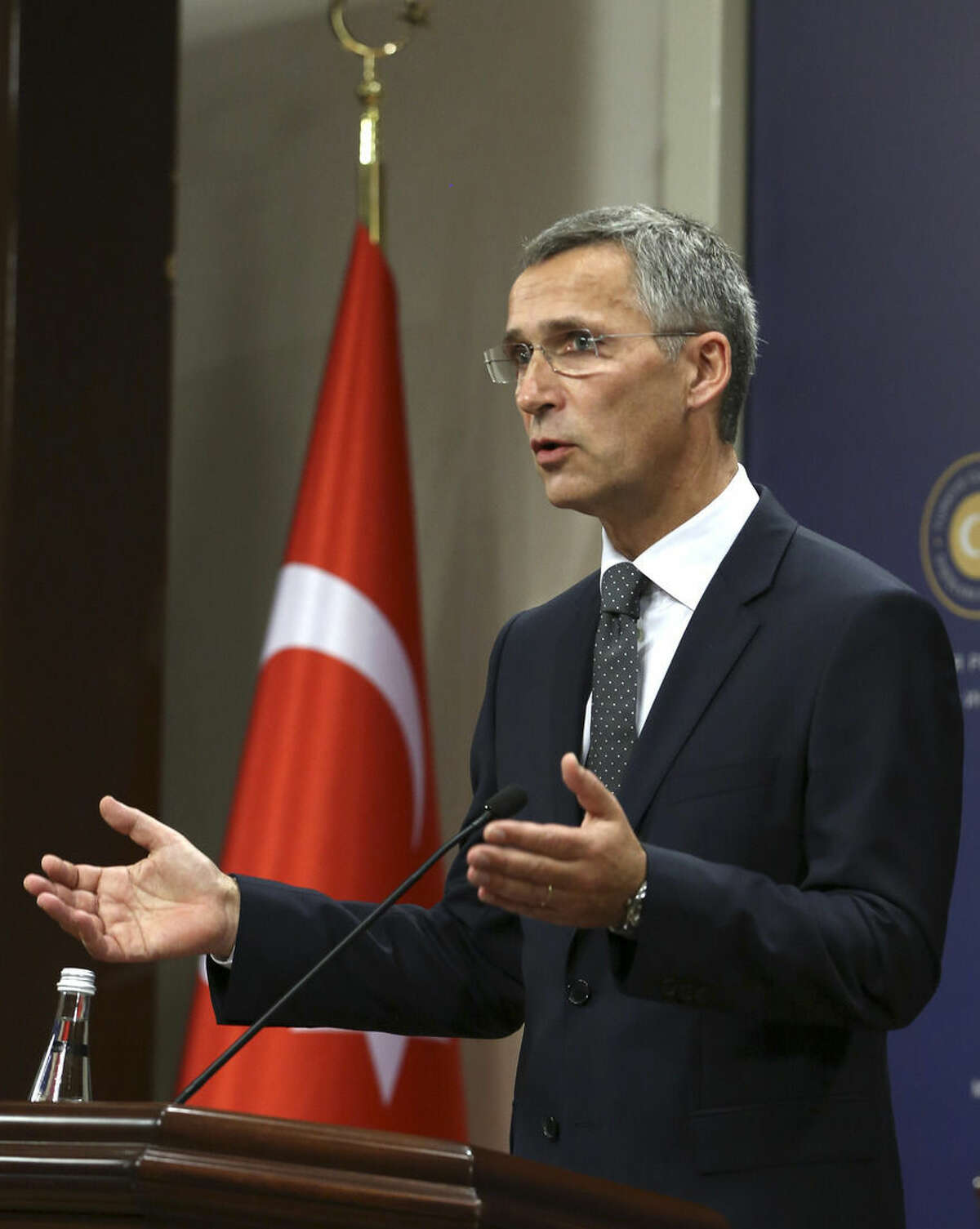 New NATO Secretary General Jens Stoltenberg speaks to the media after talks with Turkey's Foreign Minister Mevlut Cavusoglu in Ankara, Turkey, Thursday, Oct. 9, 2014. As U.S. generals and Secretary of State John Kerry warn that a strategic Syrian border town could fall to Islamic State militants, the Turkish military has deployed its tanks on its side of the frontier but only watched the slaughter. Turkey's inaction despite its supposed participation in a coalition forged to crush the extremist group is frustrating Washington and its NATO allies.(AP Photo/Burhan Ozbilici)