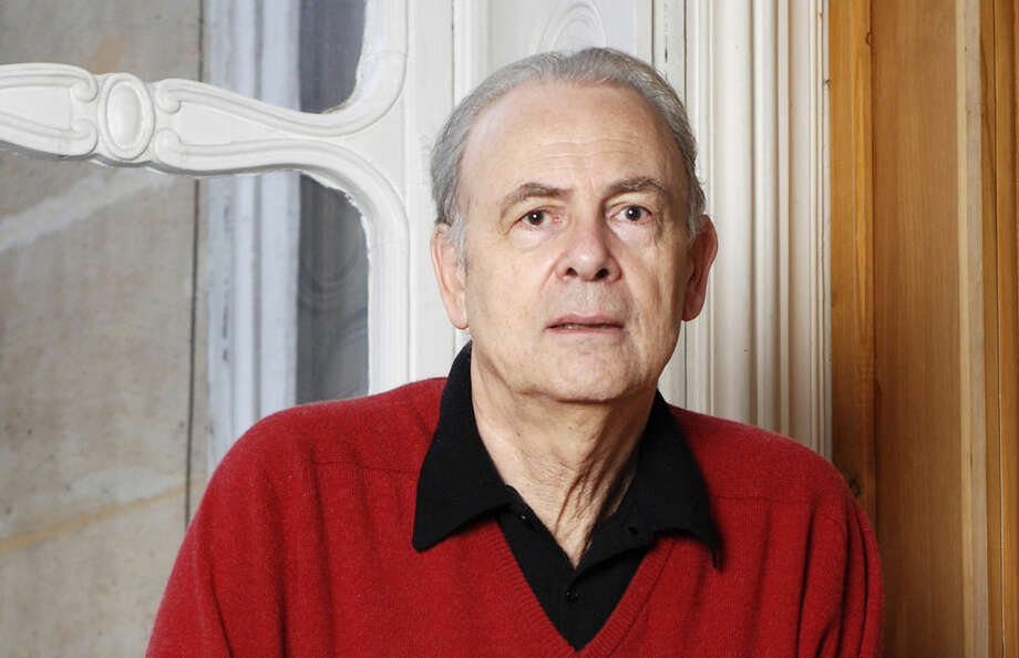 In this undated photo provided by publisher Gallimard, French novelist Patrick Modiano poses for a photograph. Patrick Modiano of France has won the 2014 Nobel Prize for Literature, it was announced Thursday, Oct. 9, 2014. (AP Photo/Gallimard)
