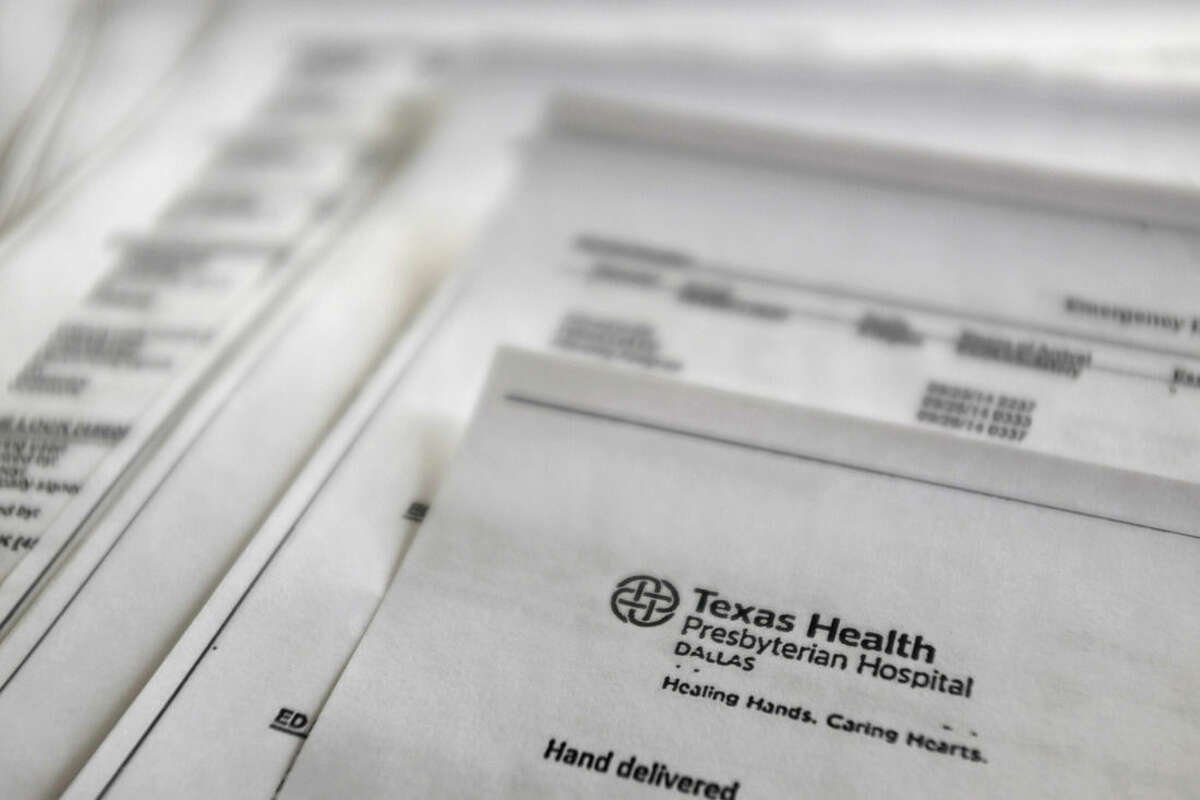 This Friday, Oct. 10, 2014 photo shows a copy of Thomas Eric Duncan's medical records from Texas Health Presbyterian Hospital, provided by Duncan's family to The Associated Press. The records encompass his time in the emergency room, his urgent return to the hospital two days later and a chronicle of his steep decline as his organs began to fail. Duncan carried the deadly Ebola virus with him from his home in Liberia, though he showed no symptoms when he left for the United States. He arrived in Dallas on Sept. 20 and fell ill several days later. (AP Photo/Kiichiro Sato)