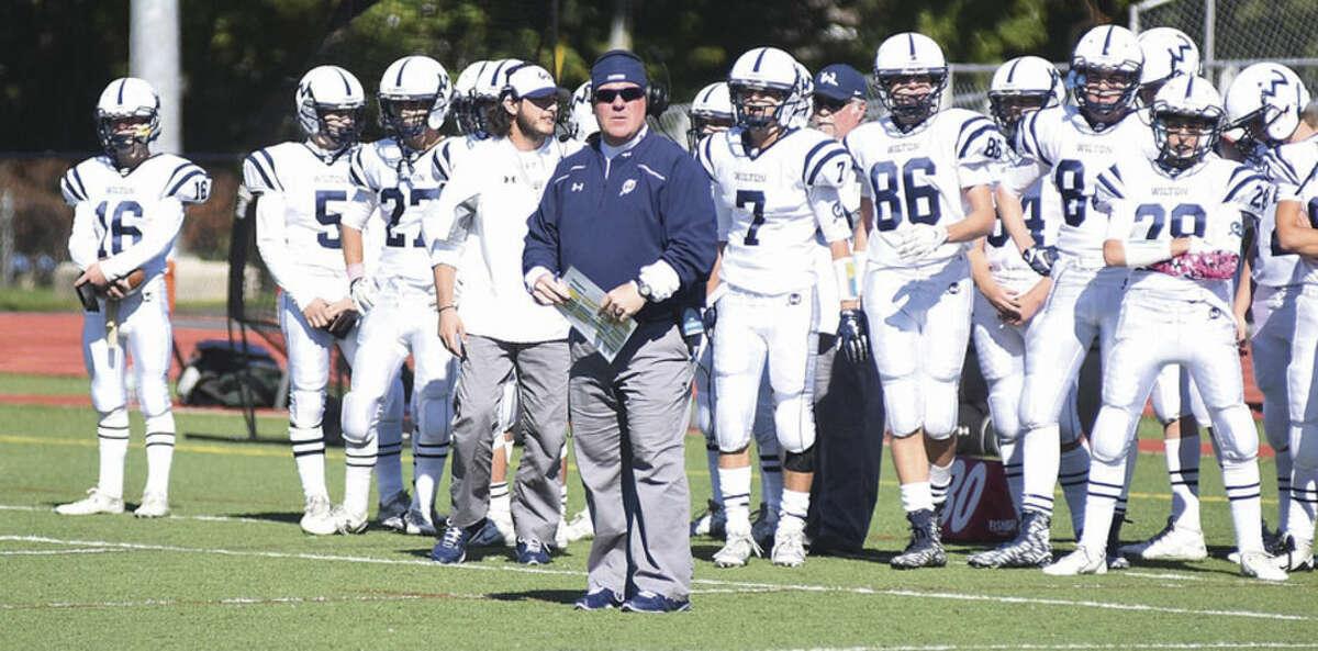 Hour photo/John Nash - Wilton head coach Bruce Cunningham, center, led a young team that grew a lot through this fall season.