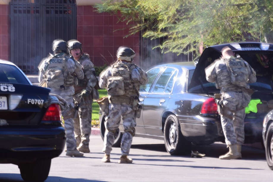 A swat team arrives at the scene of a shooting in San Bernardino, Calif. on Wednesday, Dec. 2, 2015. Police responded to reports of an active shooter at a social services facility. (Doug Saunders/Los Angeles News Group via AP) MANDATORY CREDIT