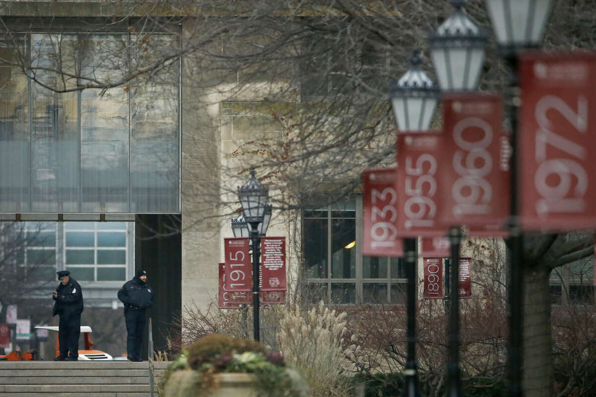 Campus security officers on the Main Quadrangles at the University of Chicago in Chicago on Monday, Nov. 30, 2015. The University of Chicago announced Sunday that all classes and other activities planned for Monday on its Hyde Park campus will be canceled after the university was informed by FBI counterterrorism officials of a gun violence threat to the campus. (Jose M. Osorio/Chicago Tribune via AP)