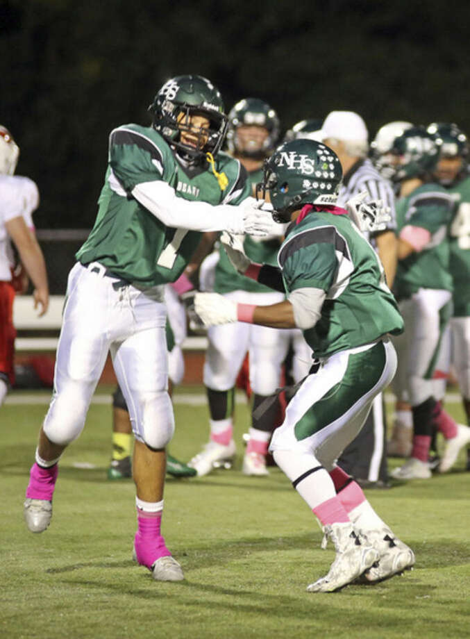 Hour Photo / Danielle CallowayNorwalk's Brendan Brown congratulates a teammate after a play during Friday night's game against Greenwich.